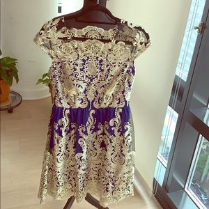 Blue and gold lace dress. Stunning!